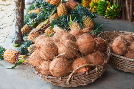 Basket with coconuts. Fresh and organic vegetables at farmers market in Sri lanka.