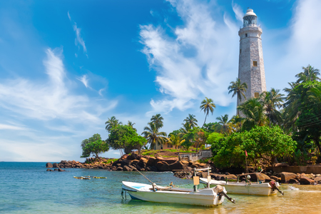 White lighthouse Dondra Head and tropical palms, Sri Lanka, near Matara.