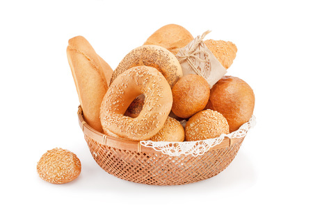 Bread and bakery products in a wicker basket isolated on white background