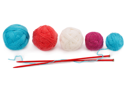 yarn balls and knitting needles isolated on white background