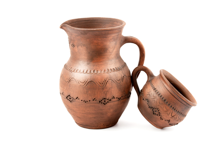 Handmade clay mug and jug isolated on a white Imagens