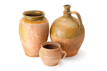 Clay old jug are handmade of different shape isolated on white