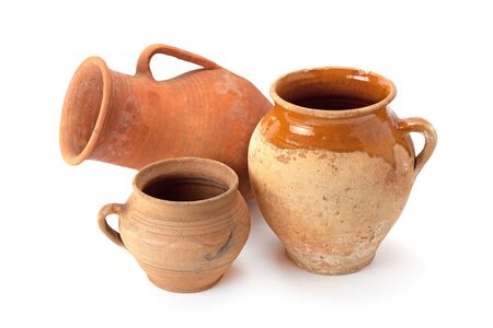 Clay old jug are handmade of different shape isolated on white background.