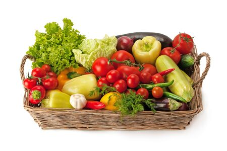 Fresh and ripe vegetables arranged in a basket isolated on white. Healthy organic food. Imagens