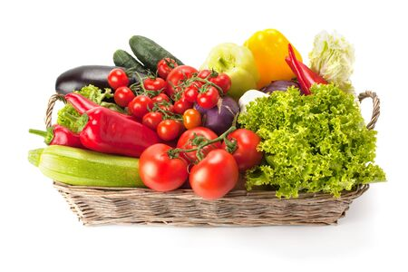 Fresh and ripe vegetables arranged in a basket isolated on white. Healthy vegan food. Archivio Fotografico