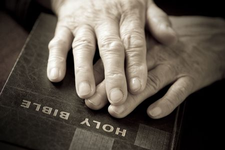 hands on the bible( focus point on fingers(selective)) Stock Photo