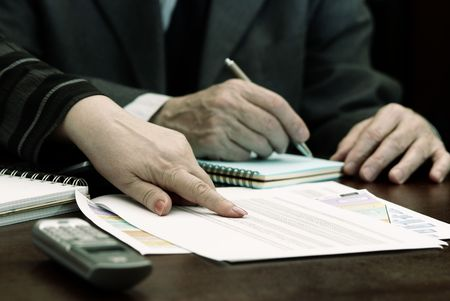 work with papers (focus point on the finger of the woman) Stock Photo - 772509