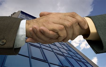 two businessmen handshaking ,made from my images Stock Photo - 814749