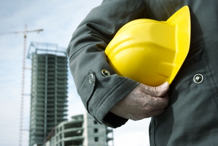 under construction (focus point on the hard-hat and hand, special photo toned f/x) Stock Photo - 833829