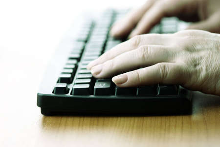 work on computer(special photo f/x. focus point on nearest finger of woman) Stock Photo - 872891