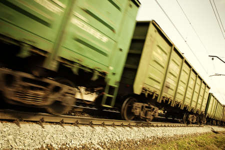 railroad tracks: special toned and blur-motion photo fx, focus point on railroad embankment and rail Stock Photo