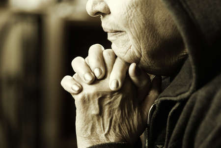 elderly hands: prayer (special sepia toned photo fx, focus point on lips and fingers(selective))
