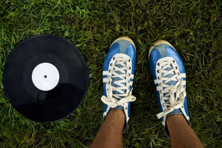 vintage shoes and disk on the green grass(special toned photo fx) photo
