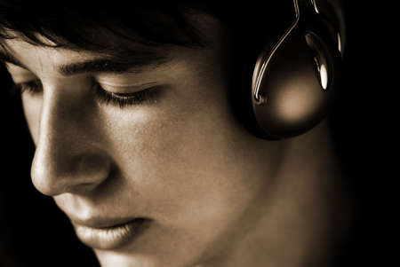 sepia toned: teen listening favorite song, sepia toned ,focus point on eye