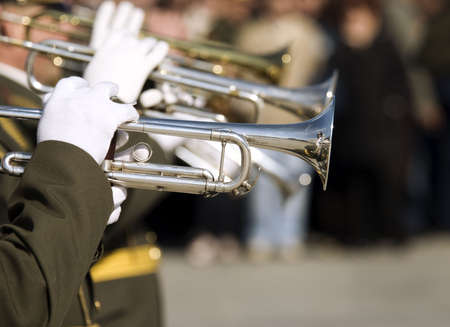 hands of musicians with trumpets (selective focus) photo