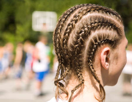 close-up of young basketball player with funny pigtails photo