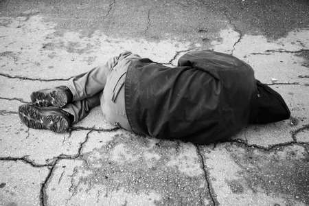 drunkenness: hobo sleep on the street Stock Photo