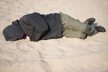 homeless man sleeping on sand Stock Photo - 3935993