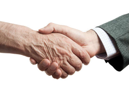 handshake of businessman and poor man, isolated on white background, focus point on center photo