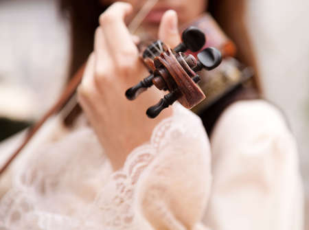man with vintage violin , selective focus on nearest part Stock Photo - 4929807