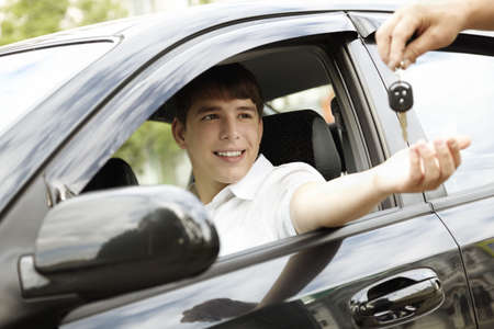 buying a car: car rent or leasing concept, selective focus on eyes