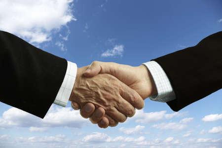 clasping: handshake of businessmen