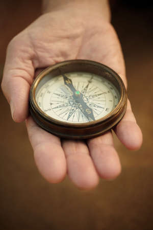 compass on the hand, selective focus,lens blur photo