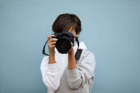 young female photographer, selective focus on nearest part photo