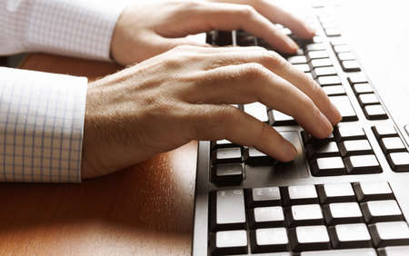 ergonomic: hands of businessman on keyboard, selective focus Stock Photo
