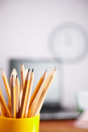 office concept with different pencils in close up, selective focus on nearest, shallow dof
