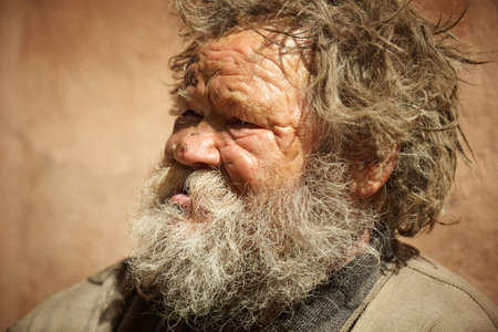 homeless man talking about hard life, special toned photo fx, focus point on eye photo