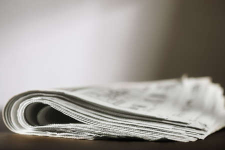 newspaper stack: newspaper