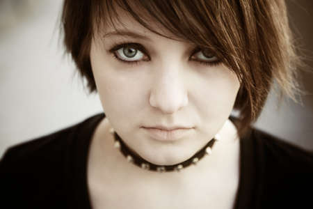 emo or goth young woman, natural soft light,selective focus on eye photo