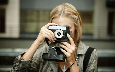 woman with small camera on the street  photo