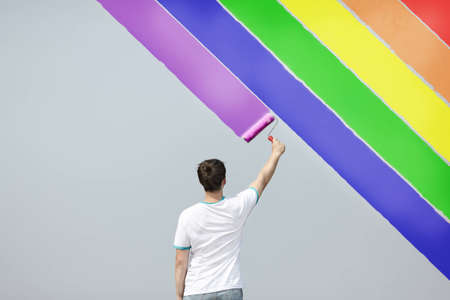lgbt: man painting the rainbow Stock Photo