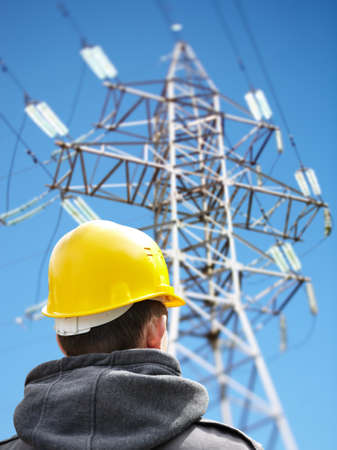 utility worker against power lines photo