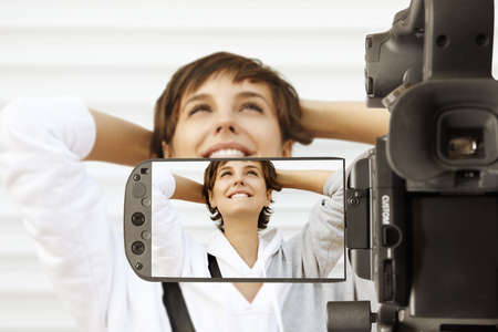 Taking movie with professional camcorder Stock Photo