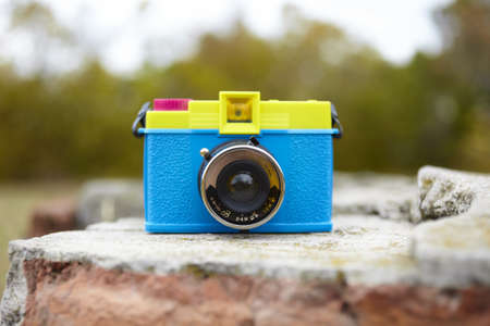 plastic toy camera in closeup, selective focus on lens