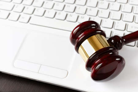 gavel on white laptop
