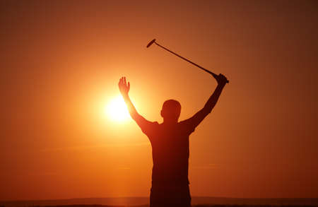 effect sunset: man play golf on sunset,selective focus on head