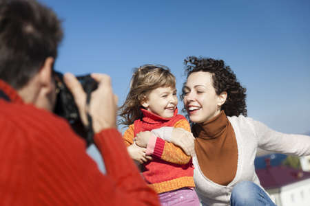 father make photos of his wife and daughter,selective focus Stock Photo - 13272197