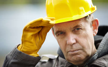 experienced: real experienced builder with yellow hardhat, natural light Stock Photo