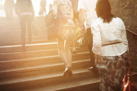 unrecognizable people are blurred with a tilt-shift lens, natural sunlight photo