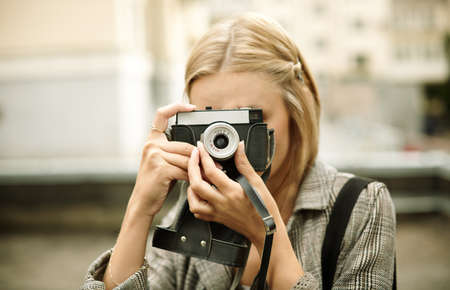 street shots: young woman with retro camera on the street Stock Photo