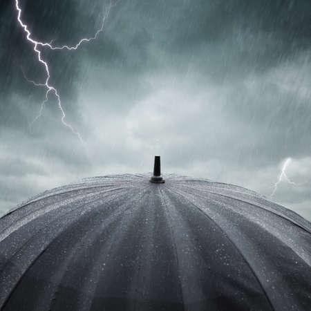 black wet umbrella , selective focus on center of photo Standard-Bild