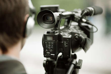 professional camcorder on the tripod photo