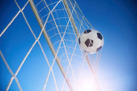 Soccer ball going into goal net  Stock Photo - 14256076