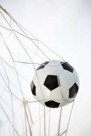 Soccer ball going into goal net  Stock Photo - 14322693