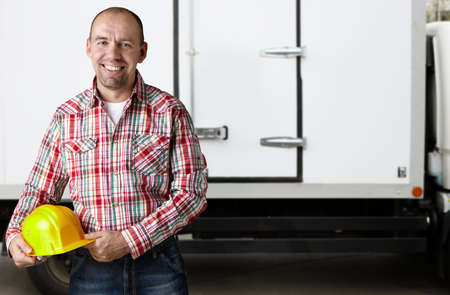 portrait of real man in  warehouse background  photo