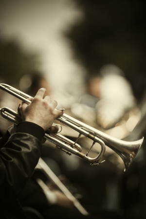 jazz band playing on the street, selective focus on the hands with trumpet ,film f/x Standard-Bild